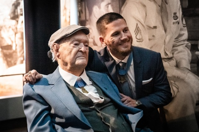 Charles H. Coolidge, the oldest living recipient of the Medal of Honor, is joined by U.S. Marine Corps Cpl. (Ret.) Kyle Carpenter, who is the youngest living Medal of Honor recipient. Both recipients were on hand for the dedication of the Charles H. Coolidge National Medal of Honor Heritage Center in Chattanooga, Tenn. on Feb. 22, 2020.