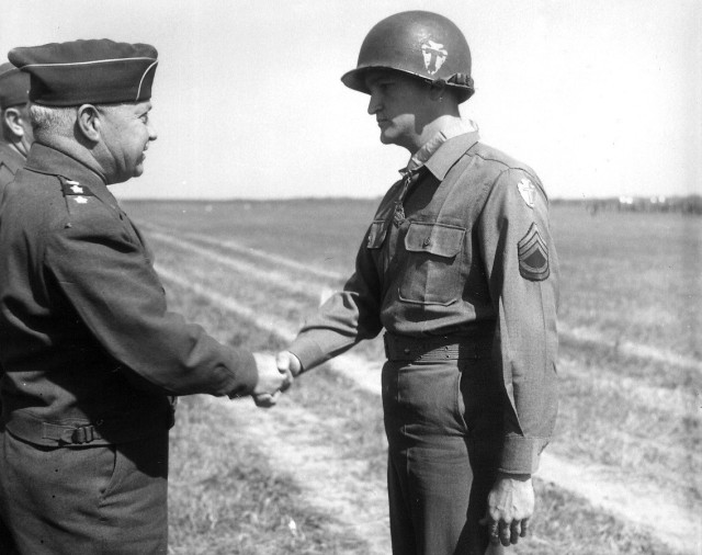 TSgt. Charles H. Coolidge receives the Medal of Honor from Army Lt. Gen. Wade H. Haislip on June 18, 1945 during a battlefield ceremony near Dormstadt, Germany. He received the medal for valorous actions east of Belmont-sur-Buttant in France from Oct. 24-27, 1944.