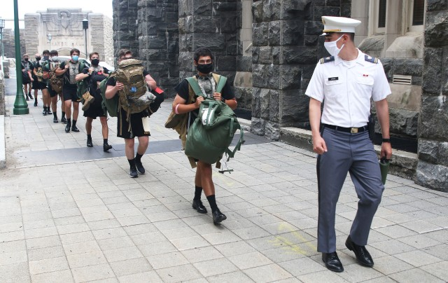 A cadet cadre member of Cadet Basic Training Alpha Company leads a group of new cadets from Thayer Hall Sunday after they received their initial issue equipment.