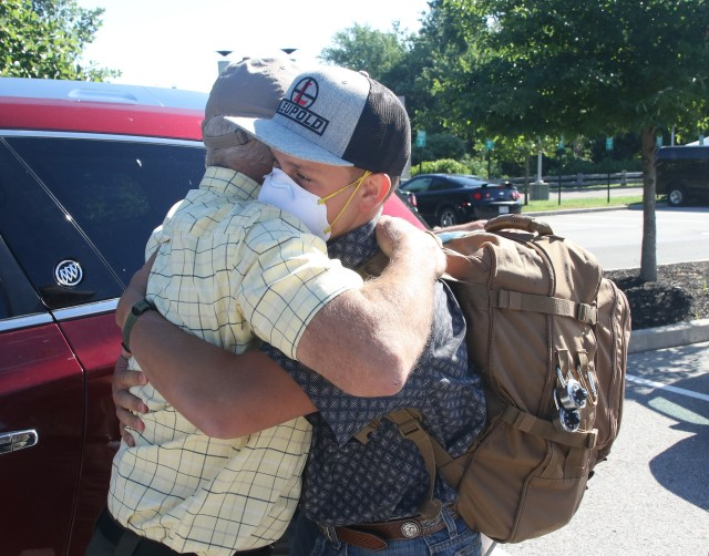New cadet Peter Wang from Devil's Lake, North Dakota, hugs his father, James, goodbye as he ventures to begin his 47-month journey at West Point Sunday on Reception Day.