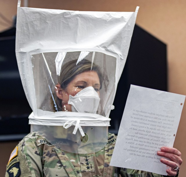 Lt. Gen. Laura Richardson, commander of U.S. Army North, goes through the safety precautions before entering the patient ward of the Edison Field Medical Site in Edison, N.J., April 13, 2020. While the peak of her command's COVID-19 response has passed, Richardson recently said it remains poised to step up and help should the need arise.