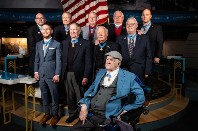"Charles H. Coolidge (front) is joined by nine other recipients of the Medal of Honor during the dedication of the Charles H. Coolidge National Medal of Honor Heritage Center in Chattanooga, Tenn. on Feb. 22, 2020. Back row (L to R): Gary B. Beikirch, Patrick H. Brady, Sammy L. Davis, Michael E. Thornton, and Matthew O. Williams. Center row (L to R) Kyle Carpenter, Walter ""Joe"" Marm, Harvey ""Barney"" Barnum, and Charles C. Hagemeister."
