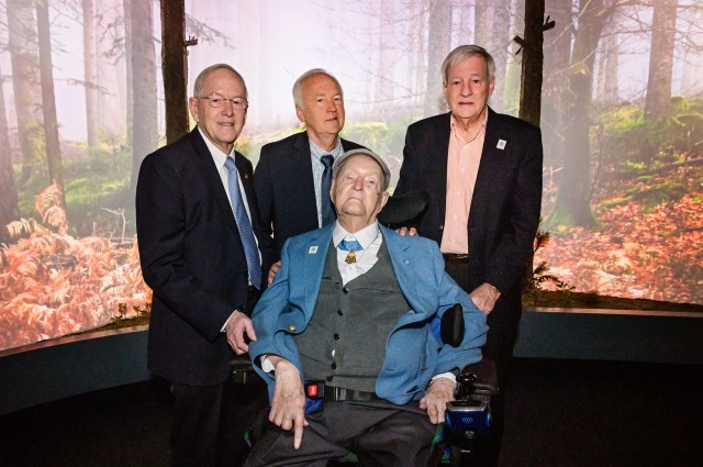 Charles H. Coolidge (front) is joined by his sons (left to right) Air Force Lt. Gen. (Ret.) Charlie Coolidge Jr., John Coolidge and Bill Coolidge during the dedication of the Charles H. Coolidge National Medal of Honor Heritage Center on Feb. 22, 2020.