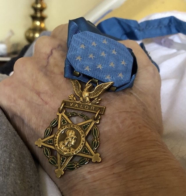 Charles H. Coolidge, a World War II recipient of the Medal of Honor, holds the medal that was presented to him by Army Lt. Gen. Wade H. Haislip on June 18, 1945 in Dormstadt, Germany, on Feb. 21, 2020. Coolidge is one of only two living recipients of the Medal of Honor from World War II.