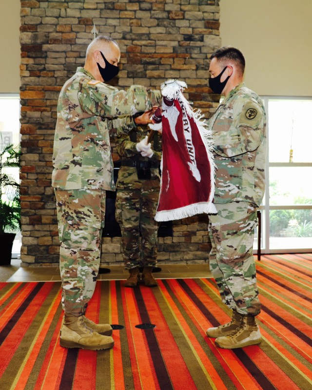 Fort Campbell Soldier Recovery Unit leaders, (from left) Command Sgt. Maj. Angel Rivera and Lt. Col. Heath Holt uncase the SRU colors. The Fort Campbell Warrior Transition Battalion was formally reflagged as the Fort Campbell Solider Recovery Unit during a reflagging ceremony on Fort Campbell, July 10. The SRU, is part of the Army Recovery Care Program, which oversees the evaluation and treatment of wounded, ill and injured Soldiers requiring six months or more of rehabilitative care and complex medical-case management. The name change reflects the restructuring of the program to update policy and procedures, to simplify entry criteria, streamline processes and focus resources to foster an environment at the unit level that will serve individual Soldiers' unique needs. US Army photo.