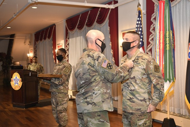 Maj. Gen. Rodney D. Fogg, CASCOM and Fort Lee commanding general, pins the Legion of Merit award on Command Sgt. Maj. Michael J. Perry III during an awards presentation held prior to the July 10 relinquishment of command ceremony honoring Perry. Perry also was presented the Gen. Brehon Somervell medallion.