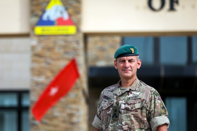 British Army Brig. Gen. Leigh Tingey, the deputy commanding general-maneuver of 1st Armored Division, poses in front of the 1AD headquarters at Fort Bliss, Texas, July 1. Tingey has served as the 1AD DCG-M since 2018 and has recently completed a deployment to Afghanistan where he served as the commander of Task Force-Southeast. (U.S. Army photo by Pfc. Matthew Marcellus)