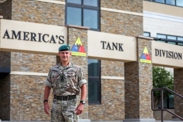 British Army Brig. Gen. Leigh Tingey, the deputy commanding general-maneuver of 1st Armored Division, poses in front of the 1AD headquarters at Fort Bliss, Texas, July 1. Tingey has recently completed a deployment to Afghanistan where he served as the commander of Task Force-Southeast, and has served as the 1AD DCG-M since 2018. (U.S. Army photo by Pfc. Matthew Marcellus)