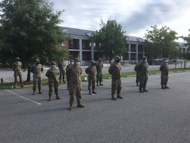 Soldiers standing in formation prior to receiving their briefing.