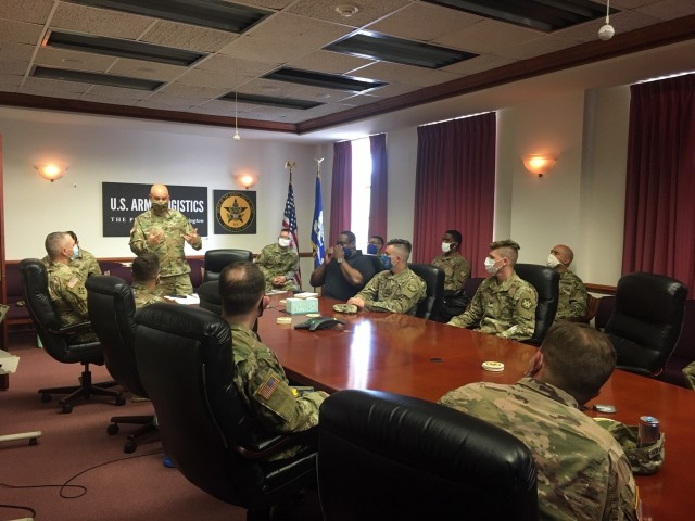 Soldiers receive a briefing on the modernization project they are about to begin.