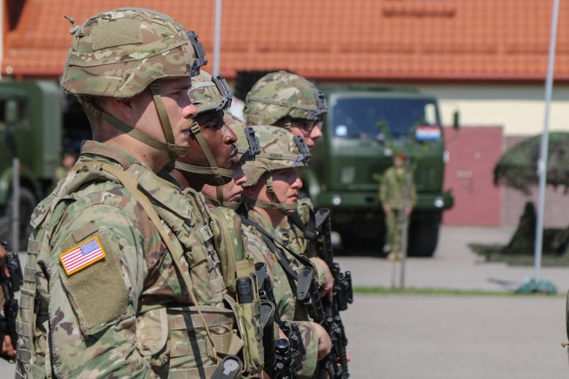 U.S. Army Soldiers assigned to 2nd Cavalry Regiment march during the pass in review portion at a change of command ceremony in Bemowo Piskie Training Area, Poland, July 17, 2020. After a 6-month rotation, 3rd Squadron, 2nd Cavalry Regiment was replaced by 2nd Squadron, 2nd Cavalry Regiment. (U.S. Army photo by Cpl. Justin W. Stafford)
