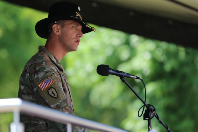 U.S. Army Lt. Col. Jeffery Higgins, the 2nd Squadron, 2nd Cavalry Regiment and incoming Battle Group Poland commander, speaks during a change of command ceremony in Bemowo Piskie Training Area, Poland, July 17, 2020. After a 6-month rotation, 3rd Squadron, 2nd Cavalry Regiment was replaced by 2nd Squadron, 2nd Cavalry Regiment. (U.S. Army photo by Cpl. Justin W. Stafford)