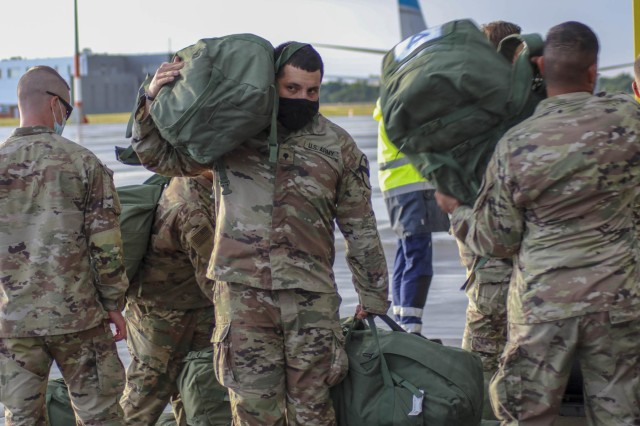 U.S. Soldiers with 2nd Battalion, 12th Cavalry Regiment, 1st Armored Brigade Combat Team, 1st Cavalry Division, arrived in Poznan, Poland on July 16, 2020. The Fort Hood based unit is deployed to participate in DEFENDER-Europe 20 Phase II at Drawsko Pomorskie Training Area, Poland. DEFENDER-Europe 20 was designed as a deployment exercise to build strategic readiness in support of the U.S. National Defense Strategy and NATO deterrence objectives. In response to COVID-19, DEFENDER-Europe 20 was modified in size and scope. Phase I of the modified DEFENDER-Europe 20 was linked exercise Allied Spirit, which took place at Drawsko Pomorskie Training Area, Poland, June 5-19, with approximately 6,000 U.S. and Polish Soldiers. In Phase II of the modified DEFENDER-Europe 20, a U.S.-based combined arms battalion will conduct an Emergency Deployment Readiness Exercise to Europe July 14 – Aug. 22. For more information about DEFENDER-Europe, visit www.eur.army.mil/DefenderEurope. (Photo courtesy of the U.S. Army)