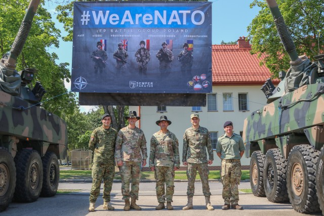 Commanders from the Croatian, Romanian, and U.K. Battle Group Poland contingents stand alongside Lt. Col. Jeffery Higgins, the incoming battle group commander, and Command Sgt. Maj. Keneti Pauulu, the incoming command sergeants major, during a change of command ceremony in Bemowo Piskie Training Area, Poland, July 17, 2020. After a 6-month rotation, 3rd Squadron, 2nd Cavalry Regiment was replaced by 2nd Squadron, 2nd Cavalry Regiment. (U.S. Army photo by Cpl. Justin W. Stafford)