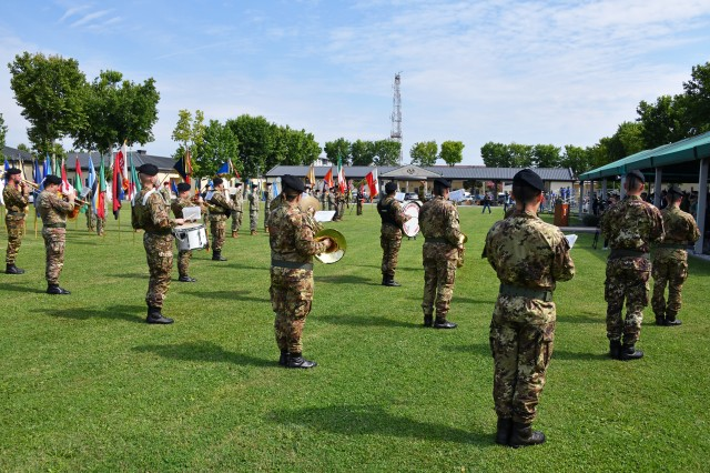 "The Italian army fanfare of the cavalry brigade, ""Pozzuolo del Friuli,"" conducted by Italian army Sgt. Cosimo Taurisano, is played during the U.S. Army Africa change of command ceremony at Caserma Ederle in Vicenza, Italy, July 15, 2020. Maj. Gen. Andrew M. Rohling assumed command of USARAF from Maj. Gen. Roger Cloutier, the outgoing commanding general. (U.S. Army photo by Paolo Bovo)"