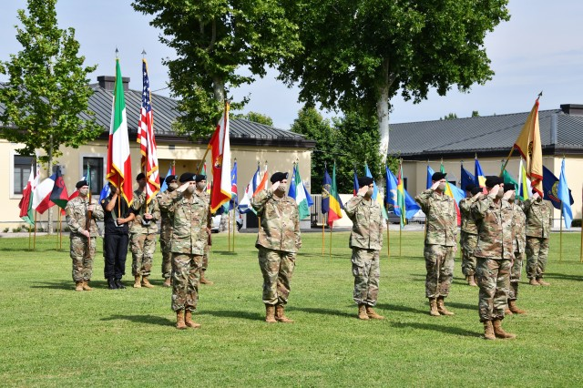 Col. John Harris, the U.S. Army Africa troop commander, front right, leads USARAF Soldiers in a salute to the flags during the USARAF change of command ceremony July 15, 2020, on Caserma Ederle in Vicenza Italy. Maj. Gen. Andrew M. Rohling assumed command of USARAF from Maj. Gen. Roger Cloutier, the outgoing commanding general. (U.S. Army photo by Paolo Bovo)