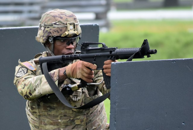 Sgt. Jordan Christopher, assigned to the 35th Combat Sustainment Support Battalion, competes in the react-to-contact portion of the U.S. Army Japan Best Warrior Competition at Sagami General Depot, Japan, July 21.