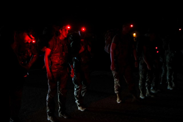 FORT BLISS, Texas - Iron Soldiers assigned to 1st Armored Division prepare to begin a 12-mile ruck march as part of the 1AD Best Warrior Competition, May 15. The competitors each had to carry a 35-pound rucksack over a predetermined course at Fort Bliss as fast as they could, with the finishers ranging from a time of 2 hours 30 minutes to 3 hours for completion. The ruck march was the first event of the competition, setting the stage for the Soldiers as they competed for the titles of 1AD Soldier of the year and Noncommissioned Officer of the year. This year's competition was won by Staff Sgt. James Ferrone, a native of Naperville, Illinois and cavalry scout assigned to Troop B,  2nd Squadron, 13th Cavalry Regiment, 3rd Armored Brigade Combat Team, and Spc. Gage Paraschos, a native of Mount Bethel, Pennsylvania and cavalry scout assigned to Troop C, 2-13 CAV, who demonstrated their knowledge, skills, physical fitness and perseverance throughout the competition, representing 1AD's continued dedication to excellence. (U.S. Army photo by Pfc. Matthew Marcellus)