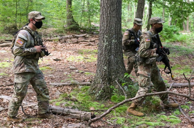 Staff Sgt. Seth Glover (left), 2nd Security Force Assistance Brigade, instructs U.S. Military Academy cadets during introduction to patrolling drills July 14 as part of Cadet Field Training.