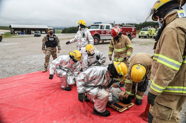 Camp Bondsteel KBR Fire and EMS transport a wounded Soldier to their triage collection point as part of active shooter training at Camp Bondsteel, Kosovo July 18, 2020. KBR Fire and EMS are responsible for assisting military installation with the treatment and transport of personnel to the base hospital. RC-E's first responders from KBR Fire and EMS, Task Force Medical and TF Aviation MEDEVAC cross-communicated so that as a collective, Regional Command East could evaluate their response time to an incident.