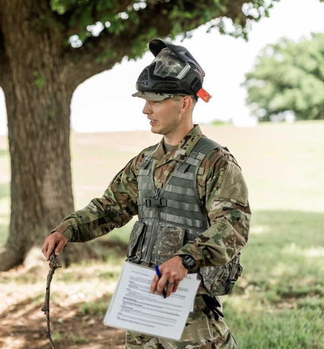 Officer Candidate Brandon Wall of class 64 gives his operations order brief to his peers as he prepares to lead his squad on a situational training exercise. Class 64 conducted training at the Kansas National Guard Range Training Complex in Salina, Kansas, June 27, 2020, in preparation of Phase III of their OCS journey. (Photo by Capt. Lauren Orr,105th Mobile Public Affairs Detachment.)