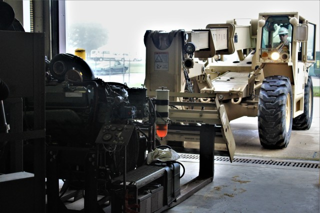Sgt. 1st Class Dain V. Crawford with Regional Training Site-Maintenance uses a forklift to rearrange equipment used for training July 16, 2020, at their facility on the cantonment area at Fort McCoy, Wis. The Regional Training Site-Maintenance staff resumed their institutional training courses in July 2020. (U.S. Army Photo by Scott T. Sturkol, Public Affairs Office, Fort McCoy, Wis.)