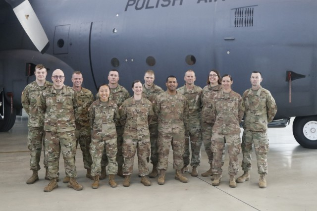 Soldiers from the 652nd Regional Support Group's Zagan cluster mayor cell teams pose together for a photo July 8 following the ceremony transferring authority from the 652nd RSG to the 297th RSG in the hangar on Powidz Air Base, Powidz, Poland. The 652nd RSG is wrapping up a nearly year-long deployment to Poland in which they led base operations on 11 base camps throughout Poland. (U.S. Army Reserve photo by Master Sgt. Ryan C. Matson, 652nd Regional Support Group)
