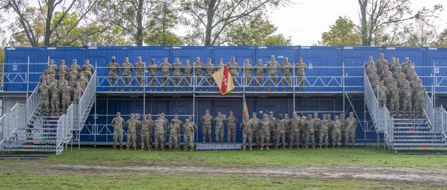 Members of the 652nd Regional Support Group, an Army Reserve unit from Helena, Montana, pose for a photograph in their work area on the Powidz Air Base, Powidz, Poland, shortly after arriving in September 2019. The 652nd was responsible for providing life-sustaining services to American Soldiers serving at 11 base camps throughout Poland. (U.S. Army Reserve photo by Master Sgt. Ryan C. Matson, 652nd Regional Support Group)