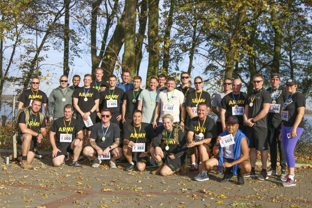 U.S. Army Reserve Soldiers from the 652nd Regional Support Group out of Helena, Montana, pose together for a group photo after participating in a 5K race October 20 in the town of Powidz, Poland. The race benefitted Julia Kapczynski, an infant from Powidz who is battling numerous health and developmental issues. (U.S. Army Reserve photo by Master Sgt. Ryan C. Matson, 652nd Regional Support Group)
