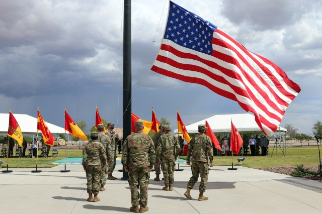 Fort Bliss, Texas - 1st Armored Division Soldiers lower the American flag in honor of British Army Brigadier Leigh Tingey, a native of Cambridge, England, the outgoing deputy commanding general-maneuver of 1AD during a farewell retreat ceremony held in his honor at Fort Bliss, Texas, July 23. (U.S. Army photo by Jean S. Han)