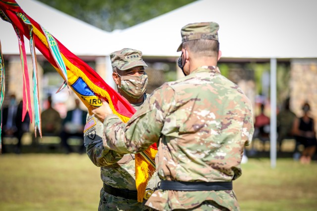 "FORT BLISS, Texas - Gen. Michael X. Garrett, the commanding general of United States Army Forces Command and native of Cleveland, Ohio, left, hands the 1st Armored Division colors to Brig. Gen. Matthew L. Eichburg, the incoming commanding general of 1st Armored Division and native of Warren, Michigan, signifying the formal transition of command during a change of command ceremony at Fort Bliss, Texas, July 28. Eichburg promised to take care of Soldiers and their families as well as to improve combat readiness, stating that ""we will do so based on a positive command climate that does not admire problems but solves them in an environment of leader development and learning."" (U.S. Army photo by Pfc. Matthew Marcellus)"