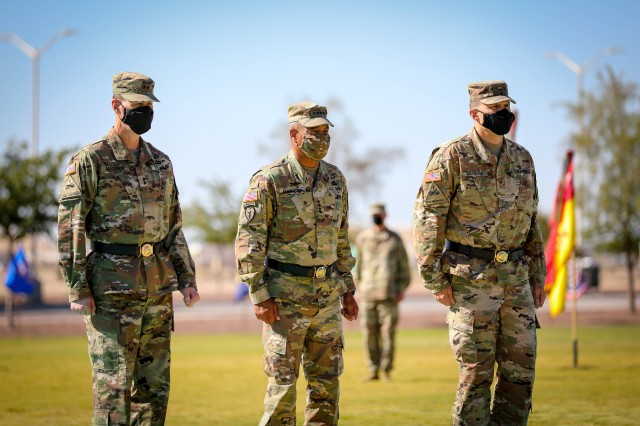 FORT BLISS, Texas - From left, Maj. Gen. Patrick E. Matlock, the outgoing commanding general of 1st Armored Division and native of Willows, California, Gen. Michael X. Garrett, the commanding general of United States Army Forces Command and native of Cleveland, Ohio, and Brig. Gen. Matthew L. Eichburg, the incoming commanding general of 1AD and native of Warren, Michigan, participate in the 1AD change of command ceremony, July 28. The change of command ceremony was a formal event signifying Eichburg's assumption of command and involved the traditional passing of the colors between Matlock, Garrett and Eichburg to represent this significant change of leadership. (U.S. Army photo by Pfc. Matthew Marcellus)