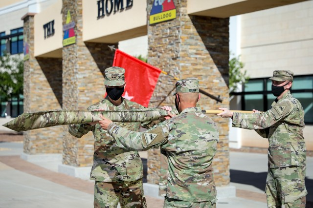 Maj. Gen. Patrick Matlock, the commanding general of 1st Armored Division and Fort Bliss, left, and Sgt. Maj. Joseph Denny, the 1AD operations sergeant major, uncase the 1AD colors at Fort Bliss, Texas, July 2, marking the official return of the battalion from a deployment to Afghanistan. 1AD's Headquarters and Headquarters Battalion deployed last summer to Afghanistan, committing approximately 250 Iron Soldiers in support of partner and coalition missions throughout the region. (U.S. Army photo by Pfc. Matthew Marcellus)