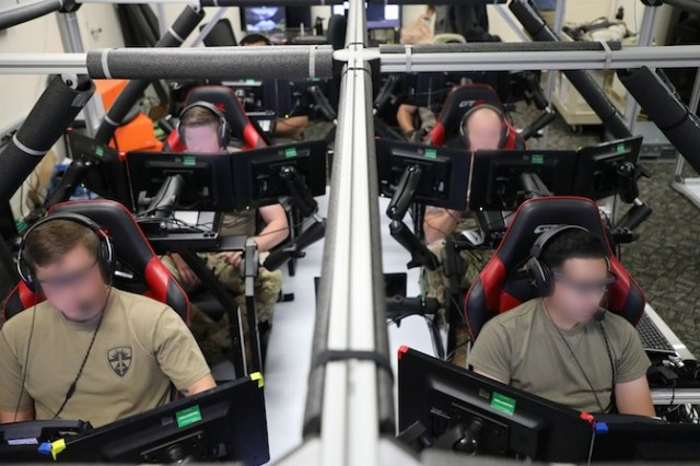 Researchers at the U.S. Army Combat Capabilities Development Command's Army Research Laboratory develop Transparent Multi-Modal Crew Interface Designs. Soldiers, shown in the Information for Mixed Squads Laboratory, test these designs that augment the warfighter machine interface used to control the Next Generation Combat Vehicle.