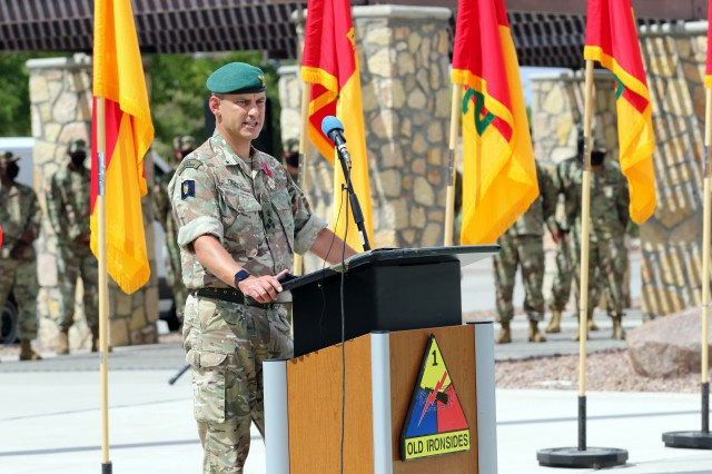 Fort Bliss, Texas - British Army Brigadier Leigh Tingey, a native of Cambridge, England, the outgoing deputy commanding general-maneuver of 1st Armored Division, reminiscences about his time with the division in a speech during a farewell retreat ceremony held in his honor at Fort Bliss, Texas, July 23. (U.S. Army photo by Jean S. Han)