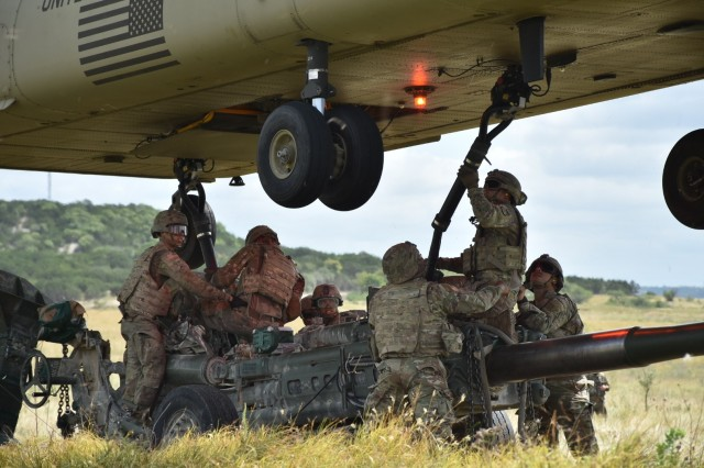 Troopers from B Battery, Field Artillery Squadron, 3rd Cavalry Regiment, prepare the M777A2 Howitzer for Sling Load by a CH47 during Steel's Gun Raid training event July 27 at Fort Hood. (U.S. Army photo by Maj. Marion Jo Nederhoed)