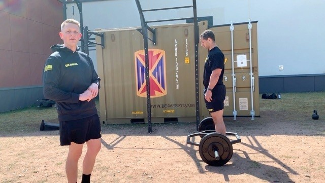 Sgt. 1st Class Johnson, assigned to the 11th Missile Defense Battery, 10th Army Air and Missile Defense Command, teaches form and technique about the dead-lift at Ramstein Air Base, Germany on July 29, 2020.