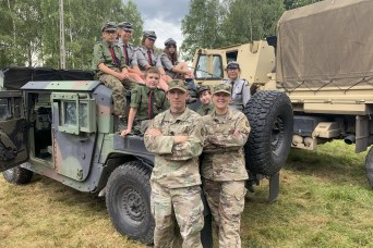 Soldiers stationed in Poland share experiences with local scouts