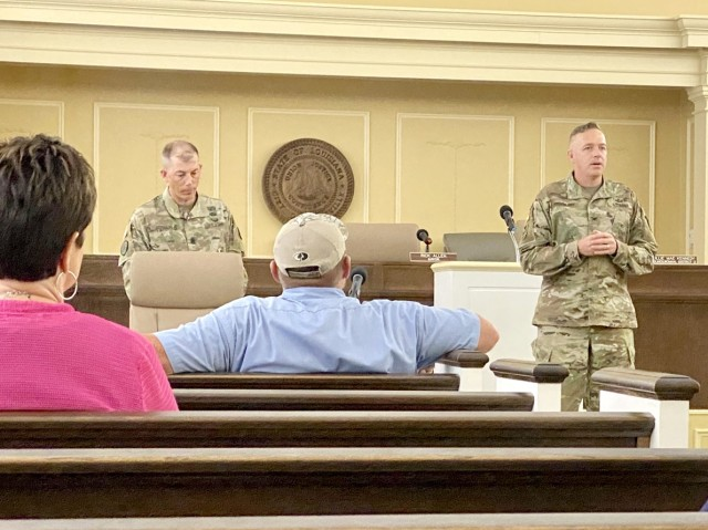 Fort Polk Army Garrison Command Sgt. Maj. Christopher Ausbun (left) and Col. Ryan K. Roseberry, commander, Fort Polk Army Garrison, teach a class on leadership to members of the city of Leesville's administrative staff July 29 at Leesville, La., City Hall.