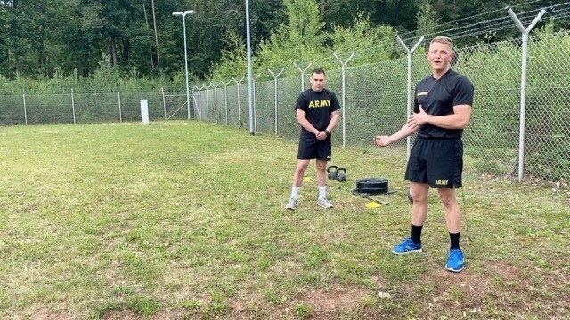 Sgt. 1st Class Johnson, assigned to the 11th Missile Defense Battery, 10th Army Air and Missile Defense Command, teaches form and technique about the sprint, drag, carry ACFT event at Ramstein Air Base, Germany on July 29, 2020.