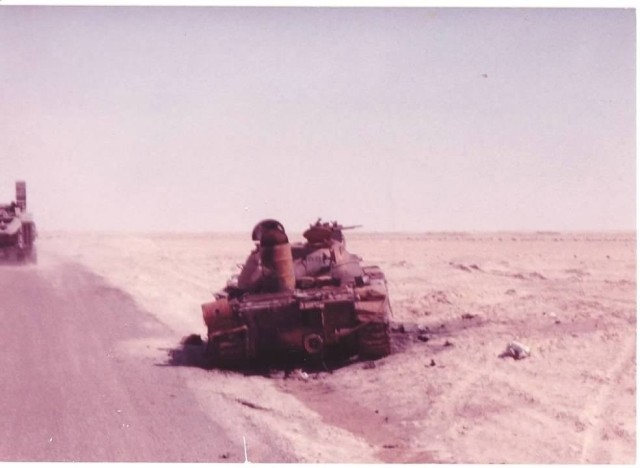 A destroyed Iraqi tank sits along a desert road in Saudi Arabia during the Gulf War. The conflict's 30th anniversary was on Aug. 2, 2020.