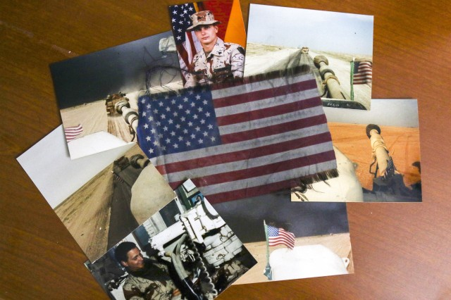 The keepsakes of then-Army Sgt. Bob Lehtonen from Operation Desert Shield/Desert Storm include several photos and the American flag he flew from his M109A2 Howitzer across deserts of the Persian Gulf in 1990 and 1991. Lehtonen went on to retire as the command sergeant major of the Field Artillery and credited his experience in the Gulf War for his Army career longevity. (Photo by U.S. Army National Guard Staff Sgt. Zach Sheely)