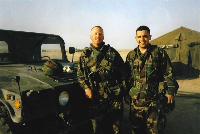 Then 1st Lt. Matthew Olander, left, and then-2nd Lt. Ken Foulks stop for a photo in Saudi Arabia during the Gulf War. Foulks, the director of field programs and historical services at the Army Center of Military History deployed to the Persian Gulf as a logistics officer assigned to the 2nd Armored Cavalry Regiment in December 1990.