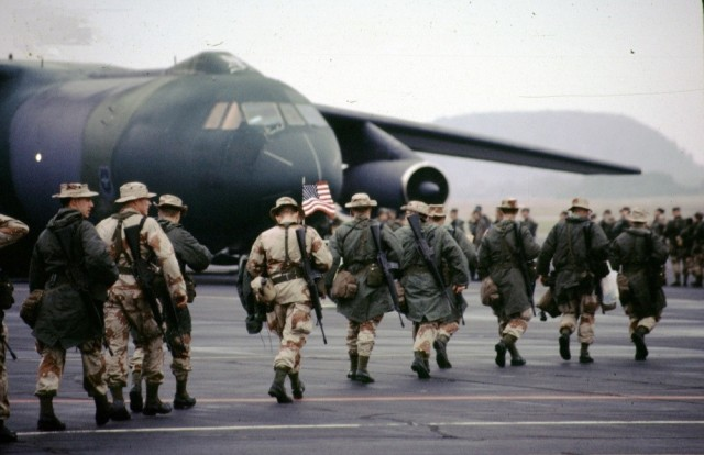 Soldiers deploying to the Gulf War make their way to a plane in 1990 at Volk Field, Wisconsin. The 30th anniversary of the conflict was on Aug. 2.
