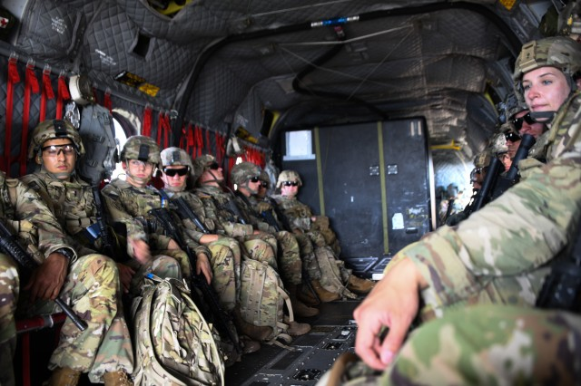 U.S. soldiers assigned to various units fly in a CH-47 Chinook to the next station for evalutation during the U.S. Army Europe European Best Warrior Competition at U.S. Army Garrison Hohenfels Training Area, Germany, July 27, 2020. The competition is an annual event with the competitors assigned to United States Army Europe and United States Army Africa. Officers, noncommissioned officers and junior enlisted Soldiers compete in separate categories and are evaluated on general military, physical fitness and common military tasks. Winners in the NCO and junior enlisted categories will advance to represent U.S. Army Europe at the Army Best Warrior Competition at For Lee, Virginia. For more information about the competition, visit https://www.eur.army.mil/EBWC/. (U.S. Army photo by Spc. Austin Riel)