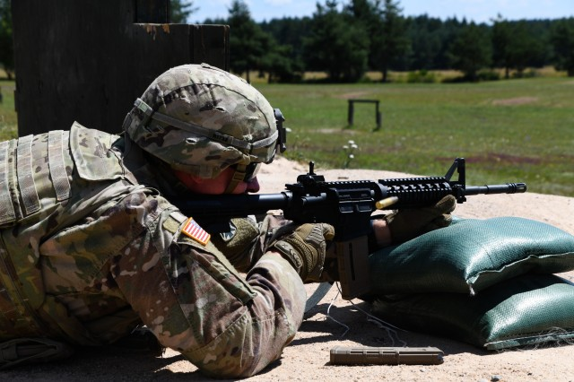 U.S. Army Spc. Justin Rivard assigned to 10th Army Air and Missile Defense Command fires at the M-16 qualification range during the U.S. Army Europe European Best Warrior Competition at U.S. Army Garrison Grafenwohr Training Area, Germany, July 27, 2020. The competition is an annual event with the competitors assigned to United States Army Europe and United States Army Africa. Officers, noncommissioned officers and junior enlisted Soldiers compete in separate categories and are evaluated on general military, physical fitness and common military tasks. Winners in the NCO and junior enlisted categories will advance to represent U.S. Army Europe at the Army Best Warrior Competition at For Lee, Virginia. For more information about the competition, visit https://www.eur.army.mil/EBWC/. (U.S. Army photo by Spc. Austin Riel)