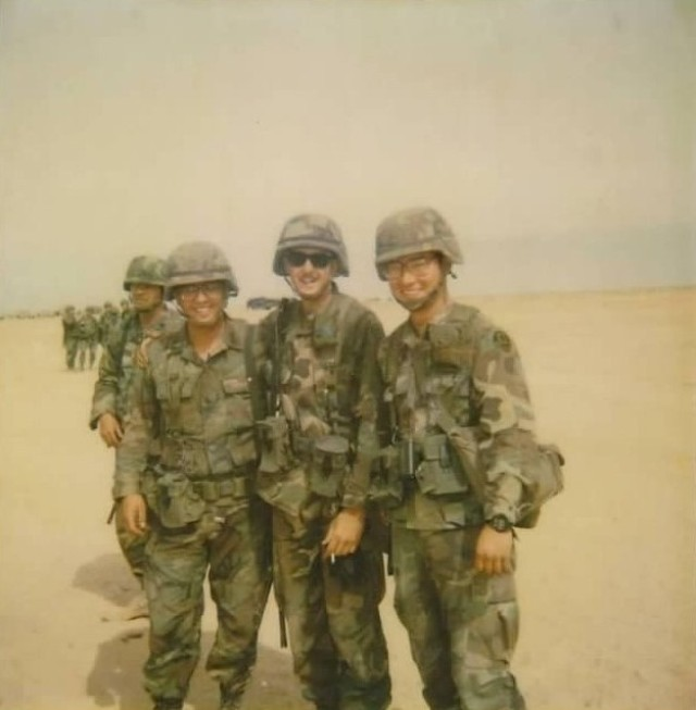 Then-2nd Lt. Ken Foulks, left, shares a laugh with fellow Soldiers while deployed to Saudi Arabia during the Gulf War.