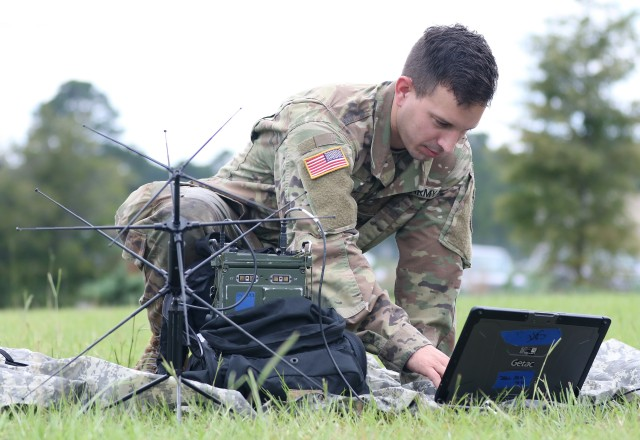 A student assigned to the U.S. Army John F. Kennedy Special Warfare Center and School, who is in the Special Forces Communications Sergeant course, practices using a PDA-184 computer and an AN/ PRC-117G satellite radio during training at the Yarborough Training Complex at Fort Bragg, North Carolina, Aug. 29, 2019. During NetModX 20, the C5ISR Center will work with DAC to assess the systems' capabilities when faced with novice, near-peer adversary and future-threat scenarios.