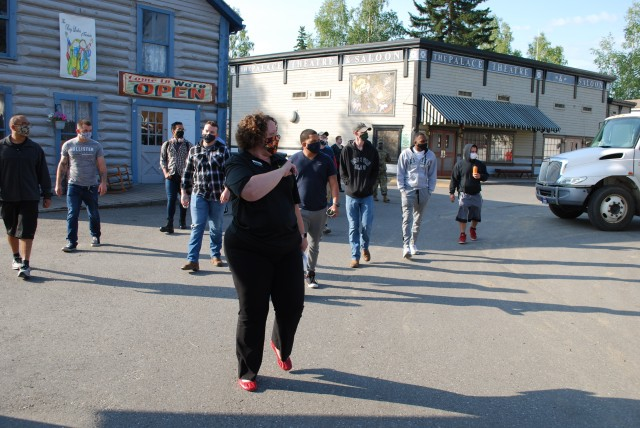 A representative from the community organization Explore Fairbanks, Charity Gadapee, guides Soldiers from Fort Wainwright on a tour through Pioneer Park in Fairbanks, Alaska. The Soldiers are participating in a newcomers orientation tour of the city.