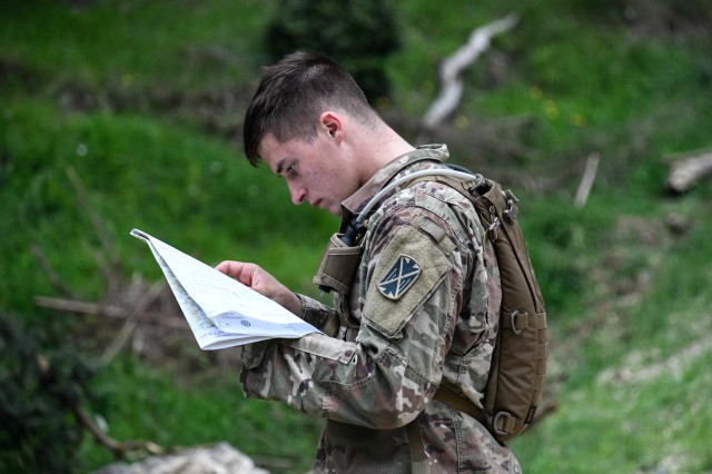 U.S. Army Spc. Justin Rivard, 10th Army Air and Missile Defense Command, plots his next grid point on the land navigation course during the U.S. Army Europe European Best Warrior Competition at U.S. Army Garrison Hohenfels Training Area, Germany, July 26, 2020. The competition is an annual event with competitors assigned to United States Army Europe and United States Army Africa. Officers, noncommissioned officers and junior enlisted Soldiers compete in separate categories and are evaluated on general military knowledge, physical fitness and common military tasks. Winners in the NCO and junior enlisted categories will advance to represent U.S. Army Europe at the Army Best Warrior Competition at Fort Lee, Virginia. For more information about the competition, visit https://www.eur.army.mil/EBWC/. (U.S. Army photo by Spc. Denice Lopez)